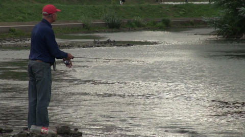 Fisherman with a fishing rod Stock Video Footage