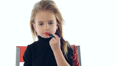 little girl makes up lips Stock Video Footage