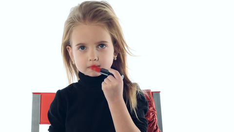 little girl makes up lips Footage