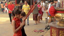 Thai-Chinese Women Praying On The Eve Of Chinese New Year stock footage