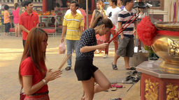Thai-Chinese Women Praying on the Eve of Chinese New Year Stock Video Footage