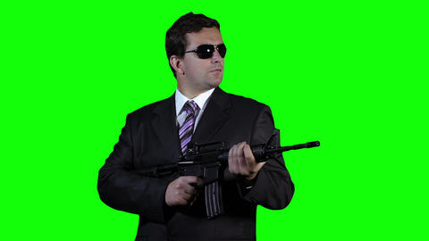 Bodyguard with Gun Watching Greenscreen 28 Stock Video Footage