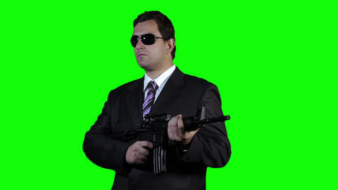 Bodyguard with Gun Watching Greenscreen 28 Footage