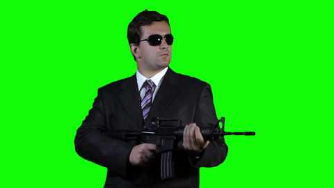 Bodyguard with Gun Watching Greenscreen 28 Stock Video Footage