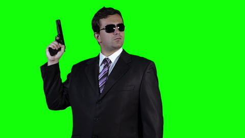 Bodyguard with Pistol Gun Watching Greenscreen 22 Stock Video Footage