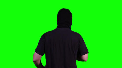 Man in Mask with Gun Action Back Greenscreen 19 Stock Video Footage