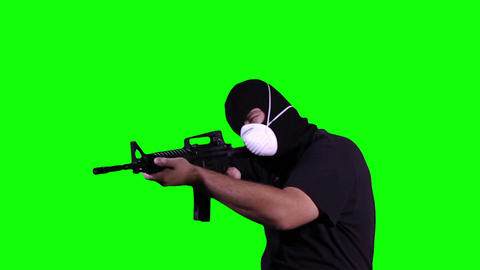 Man in Mask with Gun in Action Greenscreen 11 Stock Video Footage