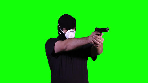 Man in Mask with Gun Pistol in Action Greenscreen 15 Footage