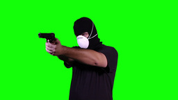 Man in Mask with Gun Pistol in Action Greenscreen 15 Stock Video Footage