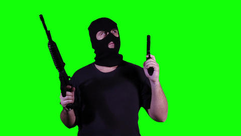 Man in Mask with Guns Watching Greenscreen 27 Stock Video Footage