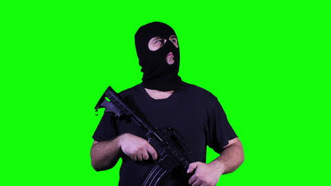 Man in Mask with Gun Watching Greenscreen 3 Footage