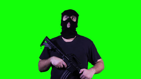 Man in Mask with Gun Watching Greenscreen 3 Stock Video Footage