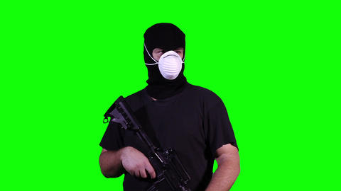 Man in Mask with Gun Watching Greenscreen 14 Footage