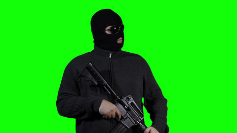 Man in Mask with Gun Watching Greenscreen 43 Footage