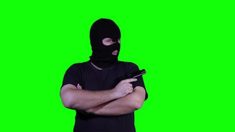 Man in Mask with Pistol Gun Watching Greenscreen 26 Stock Video Footage