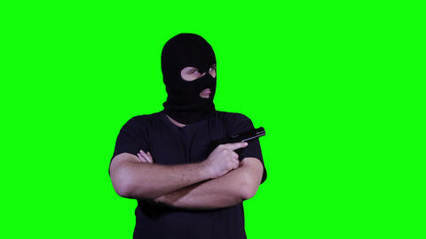 Man in Mask with Pistol Gun Watching Greenscreen 26 Footage