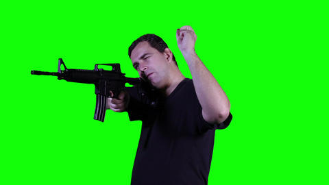 Man with Gun Action Greenscreen 7 Stock Video Footage