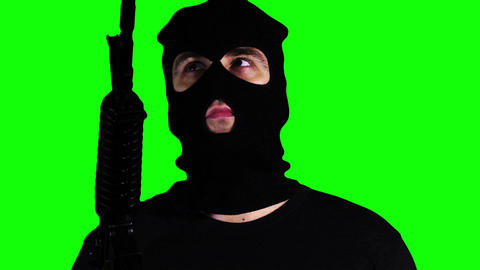 Man with Gun Watching Closeup Greenscreen 58 Footage
