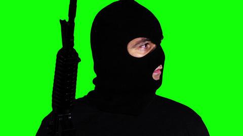 Man with Gun Watching Closeup Greenscreen 58 Stock Video Footage