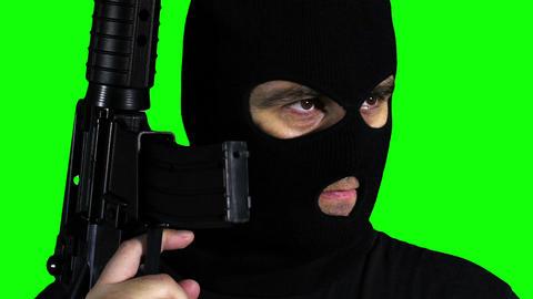 Man with Gun Watching Closeup Greenscreen 62 Stock Video Footage