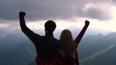 Overhead shot - Hiking couple raise arms Live Action
