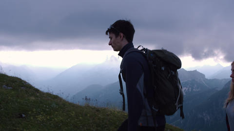 Tired people hiking in the mountains Footage