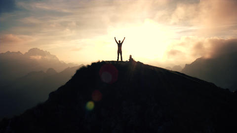 Aerial, edited - Silhouette of a man standing on top of the mountain Footage
