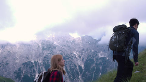 Two people hiking on the mountain Footage