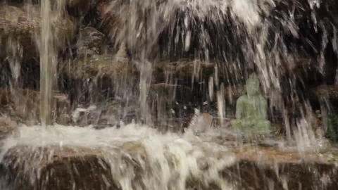 Buddha statue inside waterfall Footage