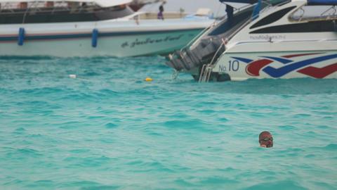 Man swimming near speedboat Footage