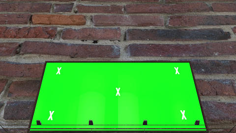 Green screen, chroma key billboard in front of brick wall. Video mock up for advertisement Animation