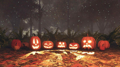 Jack-o-lantern pumpkins in magical night forest Footage