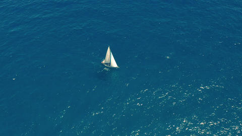 Aerial view. Yacht sailing on open sea at sunny day. Sailing boat in sea Live Action