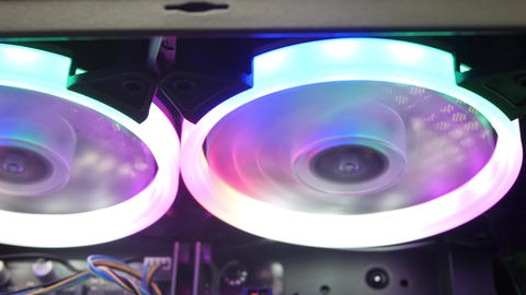 Cooling Fans Illuminated by LEDs Inside Personal Computer Footage