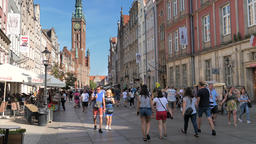 People in the old town of Gdansk, Poland. The town hall tower in the background Live Action
