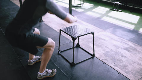Daily routine exersize in gym box jump Live Action
