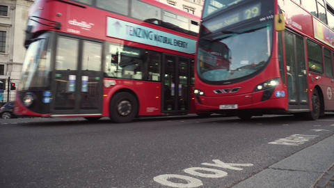 London, United Kingdom - May 13, 2019: Transportation in London. Red Bus and Live Action