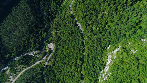 Mountain serpentine narrow meandering road view from the top. Caucasus mountain Live Action