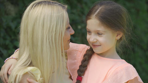 Portrait of mom kissing her little daughter. Cute blond…, Live Action
