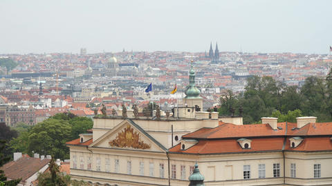 Panorama of Prague city in cloudy weather, German and European union flags on Live Action