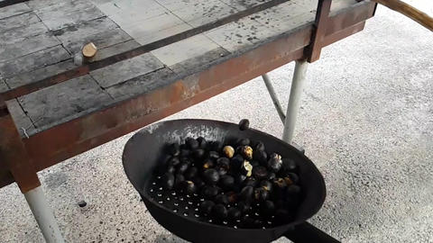 Chestnuts blown up on a traditional pan Footage
