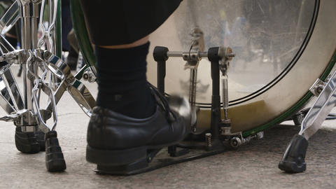 Close up male drummer feet playing music on bass drum pedal. Man playing music Live Action