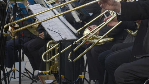 Musical band playing on wind instruments. Street musicians play music on Footage