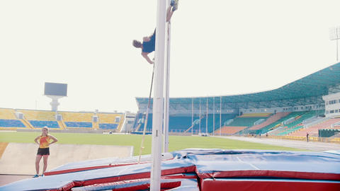KAZAN, RUSSIA 26-07-2019: young people on pole vault training - a man training Live Action