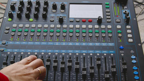 DJ controller for mixing music on performance. Sound engineer using console for Live Action