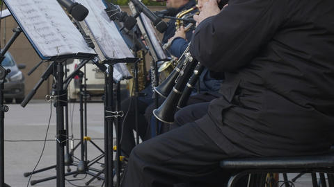 Musical band playing on oboe outdoor. Male musician play music on wind Footage