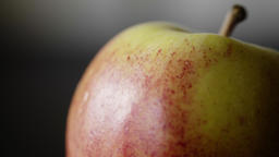 An Apple against a subtle soft grey background UHD stock footage Footage