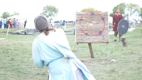 BULGAR, RUSSIA 11-08-2019: A person throwing a spear in the wooden target Live Action