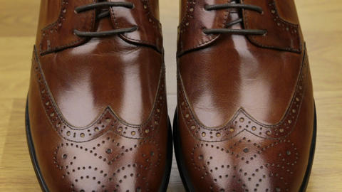 Approaching, pair of brown classic men's shoes standing... Stock Video Footage