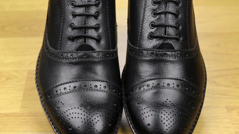 Approaching, pair of black classic men's shoes standing... Stock Video Footage